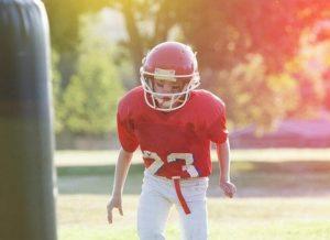 Boy in football uniform