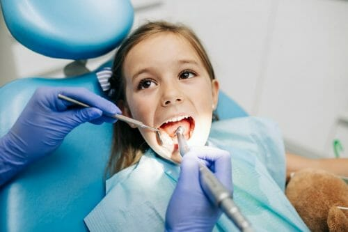 girl getting teeth cleaning